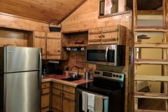 Kitchen with all the modern amenities and a ladder to the loft
